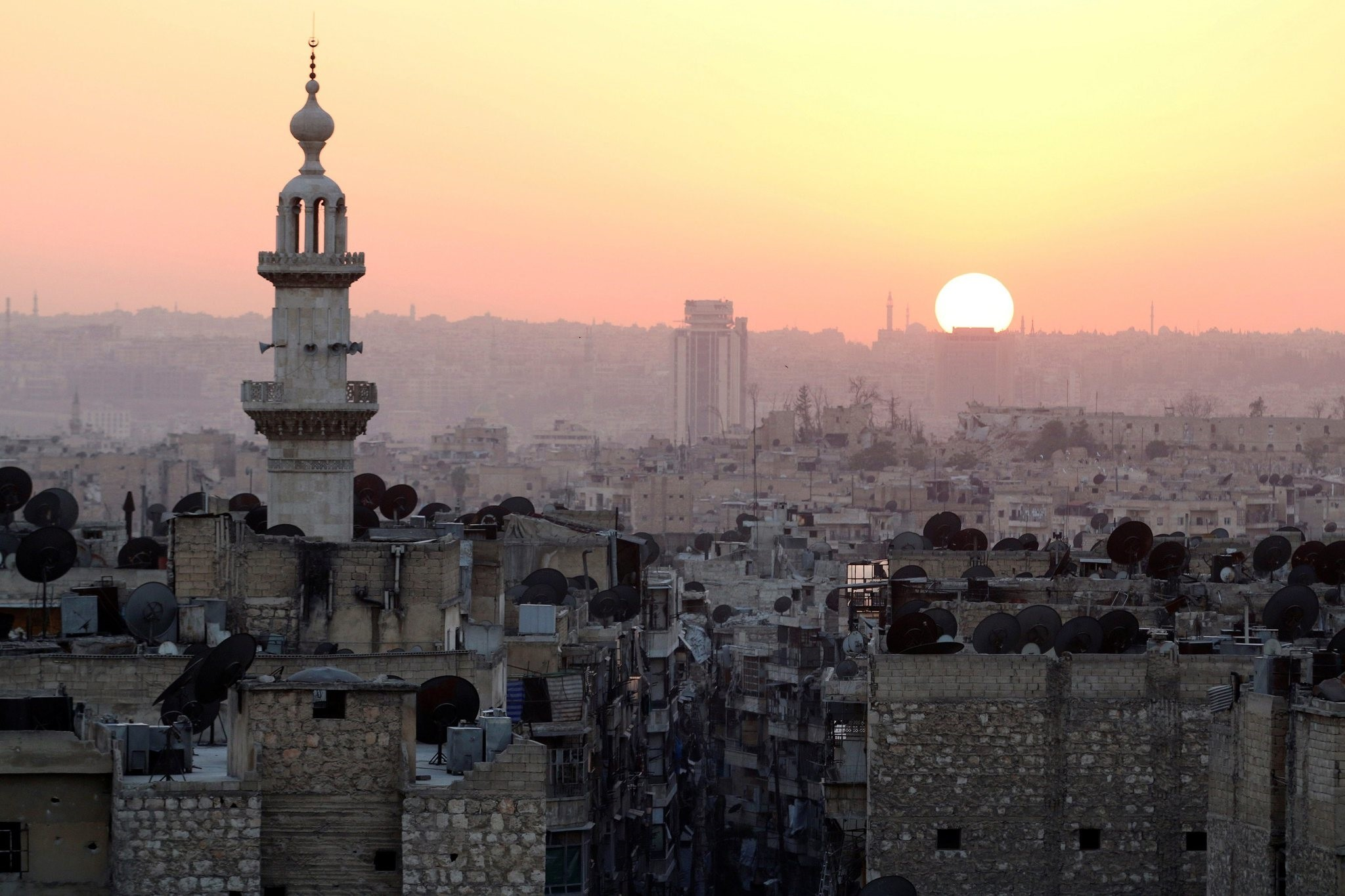 The sun sets over Aleppo, as seen from what was then the opposition-held part of the city, Syria, Oct. 5, 2016.