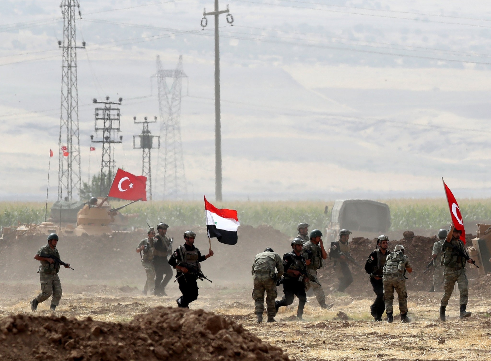 Turkish and Iraqi soldiers wave their countries' national flags during a military exercise near the Turkish-Iraqi border in the Silopi district, u015eu0131rnak, Turkey, Sept. 26.