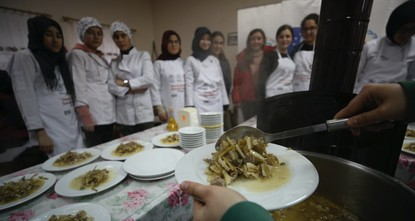 Village women teach forgotten local dishes to students
