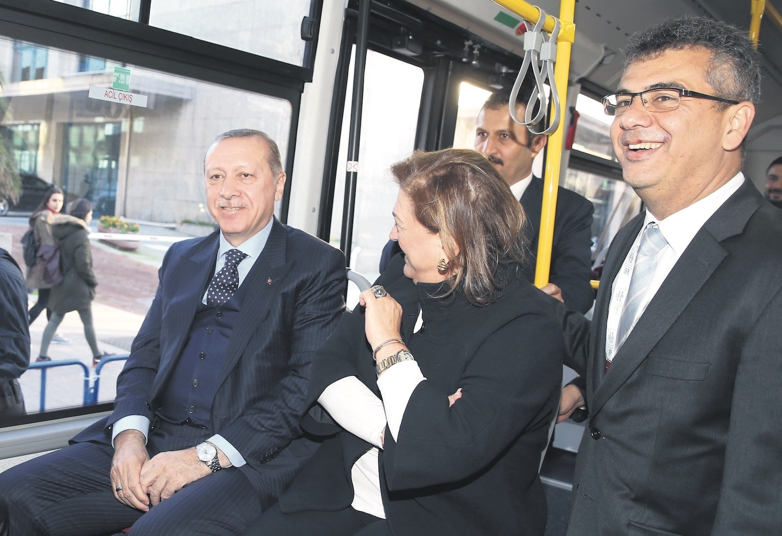 President Erdou011fan (L) test drives Temsau2019s electric bus with Sabancu0131 Holding Chair Gu00fcler Sabancu0131 (C) in Istanbul after the Innovation and Enterpreneurship Week, Dec. 9.