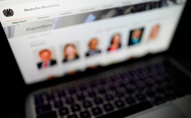 This Jan. 4, 2019 photo shows the website of the German Bundestag (lower house of parliament) with pictures of delegates displayed on the screen of a laptop. (AFP Photo)