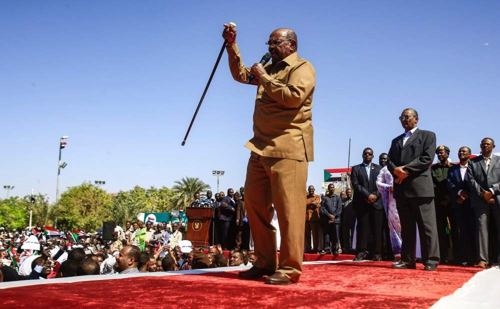 Sudan's President Omar al-Bashir speaks during a rally with his supporters in the Green Square, Khartoum, Jan. 9.