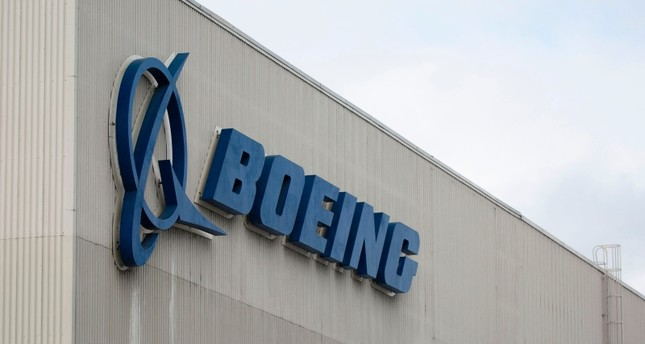 In this file photo taken on March 12, 2019 the Boeing logo is pictured at the Boeing Renton Factory in Renton, Washington (AFP Photo)