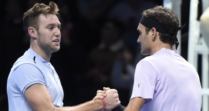pRoger Federer joked that he should have taken aim at Jack Sock after the American escaped unscathed despite bizarrely turning his backside towards the Wimbledon champion in their ATP Tour Finals...