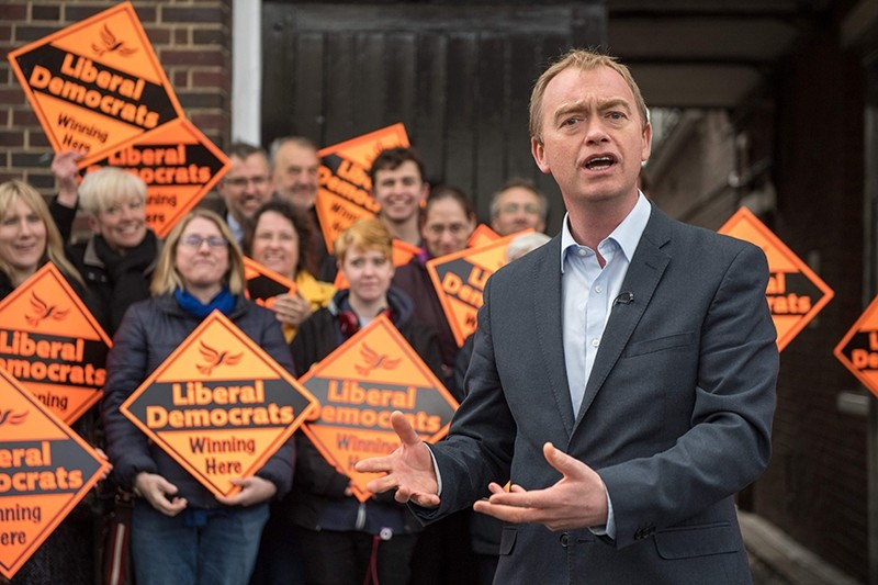 This file photo taken on April 26, 2017 shows  Liberal Democrats party leader Tim Farron speaks to supporters whilst visiting the National Pharmacy Association in St Albans (AFP Photo)