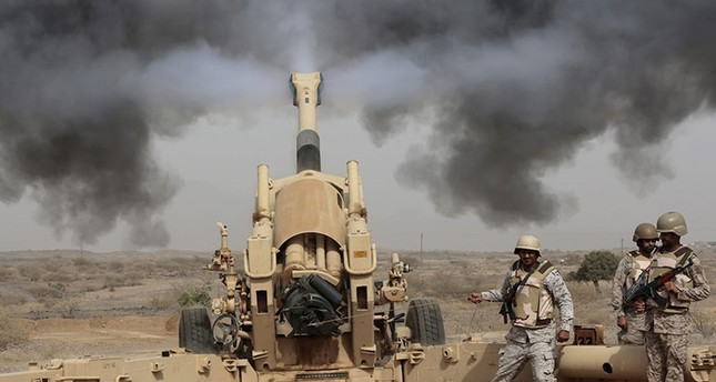 In this April 20, 2015 file photo, Saudi soldiers fire artillery toward three armed vehicles approaching the Saudi border with Yemen in Jazan, Saudi Arabia. (AP Photo)
