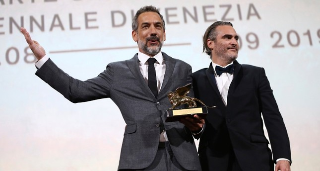 Director Todd Phillips, left, holds the Golden Lion for Best Film for 'Joker', joined by lead actor Joaquin Phoenix at the closing ceremony of the 76th Venice Film Festival, Venice, Italy, Saturday, Sept. 7, 2019. Photo by Joel C Ryan/Invision/AP