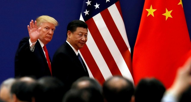U.S. President Donald Trump and China's President Xi Jinping meet business leaders at the Great Hall of the People in Beijing, China, November 9, 2017. (REUTERS Photo)