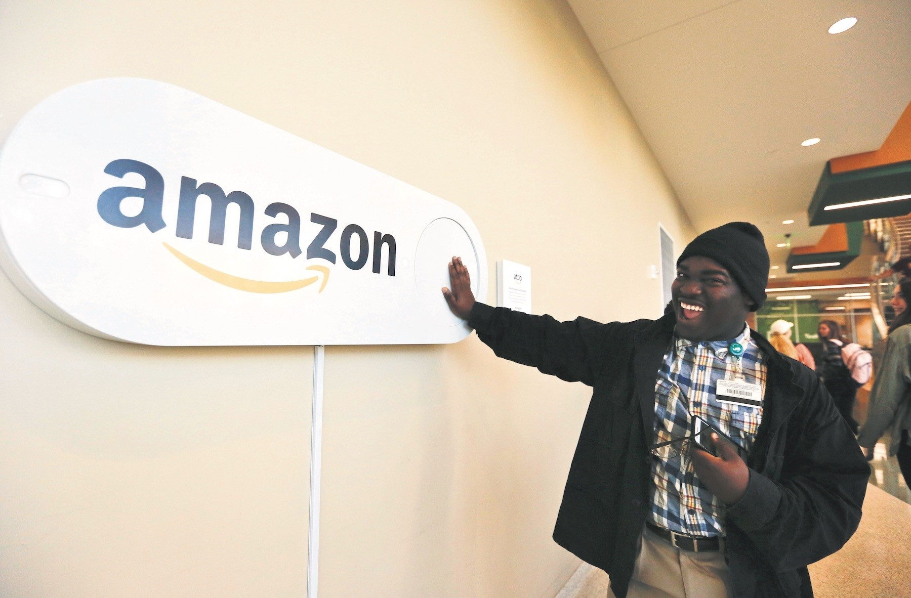 Zavian Tate, a student at the University of Alabama at Birmingham, pushes a large Amazon Dash button, in Birmingham, AL. The buttons are part of the cityu2019s campaign to lure Amazonu2019s second headquarters to Birmingham.