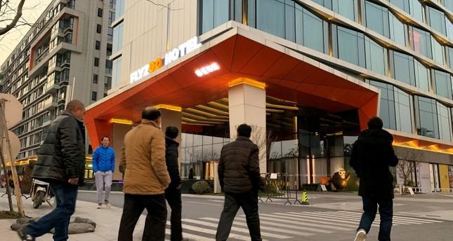 Men walk past Alibaba Group's futuristic FlyZoo hotel in Hangzhou, Zhejiang province, China Jan. 22, 2019 (Reuters Photo)