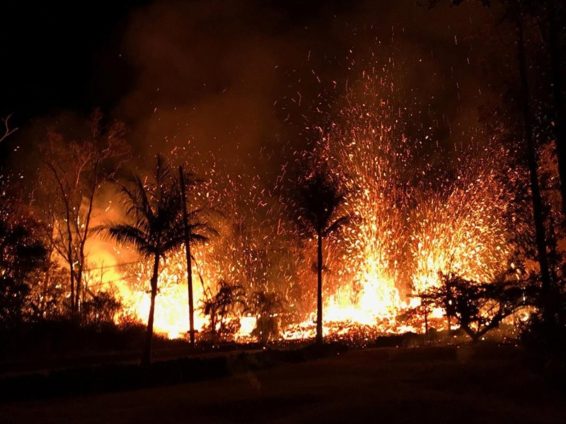 A new fissure spraying lava fountains, according to United States Geological Survey, is shown from Luana Street in Leilani Estates subdivision on Kilauea Volcano's lower East Rift Zone in Hawaii, U.S., May 5, 2018. (Reuters Photo)