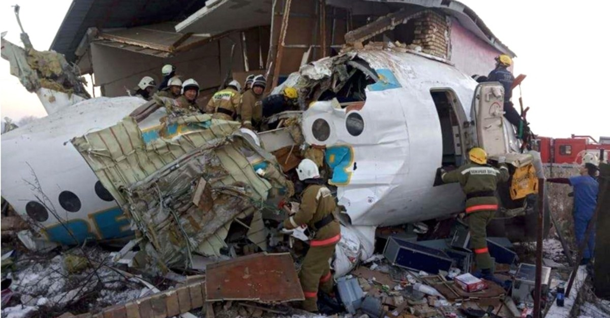 police and rescuers work on the side of a plane crash near Almaty International Airport, outside Almaty, Kazakhstan, Friday, Dec. 27, 2019. (Emergency Situations Ministry of the Republic of Kazakhstan photo via AP)