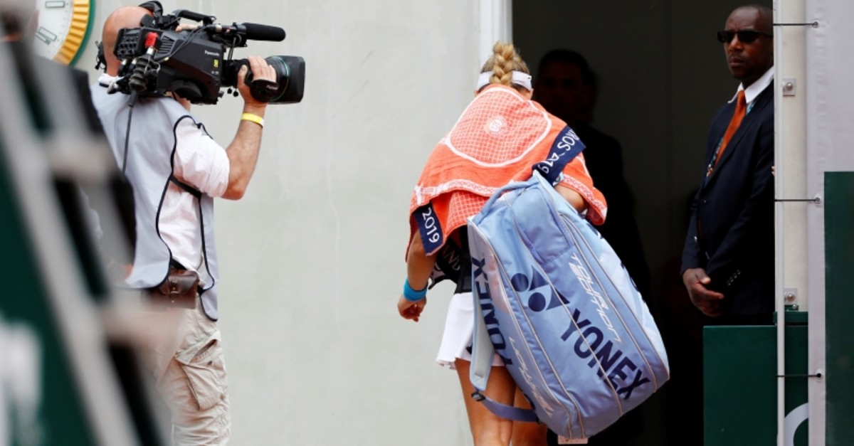 Germany's Angelique Kerber leaves the court after losing her first round match against Russia's Anastasia Potapova at the French Open tennis tournament at the Roland Garros stadium in Paris, Sunday, May 26, 2019. (Reuters Photo)