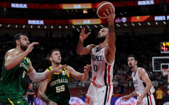 Evan Fournier of France goes for a shot over Andrew Bogut, left, and Mitch Creek of Australia during their third placing match for the FIBA Basketball World Cup at the Cadillac Arena in Beijing, Saturday, Sept. 13, 2019. AP Photo