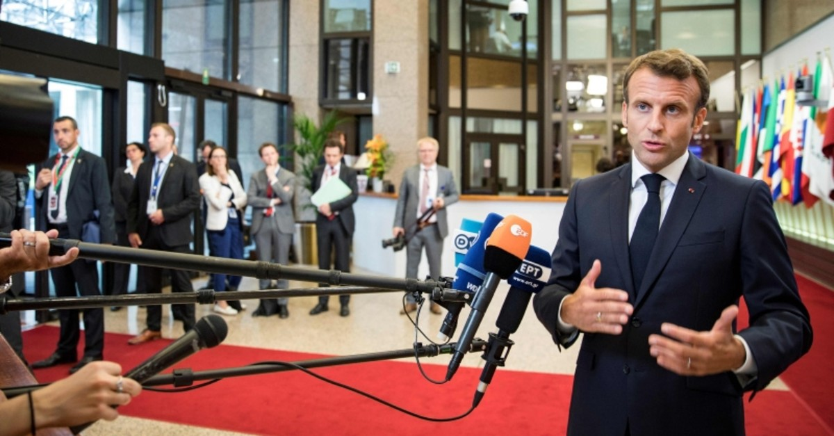France's President Emmanuel Macron gestures as he speaks to the press at the end of a EU summit at the Europa building in Brussels, on July 1, 2019. (AFP Photo)