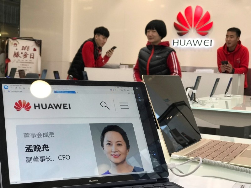 A profile of Huawei's chief financial officer Meng Wanzhou is displayed on a Huawei computer at a Huawei store in Beijing, China, Thursday, Dec. 6, 2018. (AP Photo)