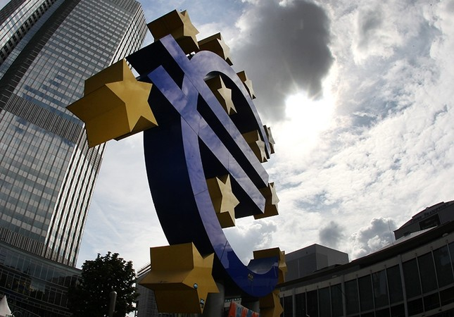 This July 31, 2012 file photo shows the euro sculpture in front of the headquarters of the European Central Bank, ECB, in Frankfurt, Germany. (AP Photo)