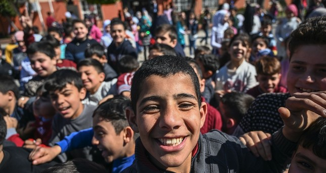 Syrian students play during their break in southern Adana province, March 18, 2019.