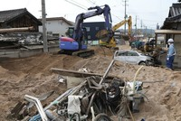 Japan flood death toll climbs above 200, local media say