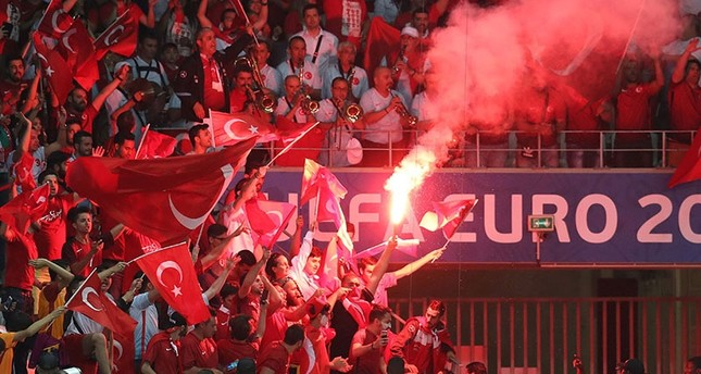 Turkish supporters wave the national flag and a flare during Euro 2016 group football match between Spain and Turkey at the Allianz Riviera stadium in Nice on June 17, 2016. (AFP)