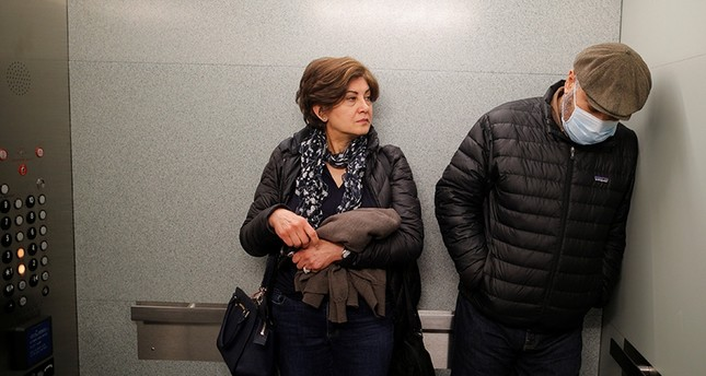 Patient Maziar Hashemi (R), who has the cancer Myelodysplastic syndrome, and his wife Fereshteh leave in an elevator after meeting with his transplant doctor at a hospital in Boston, Massachusetts, U.S., March 26, 2018. (Reuters Photo)