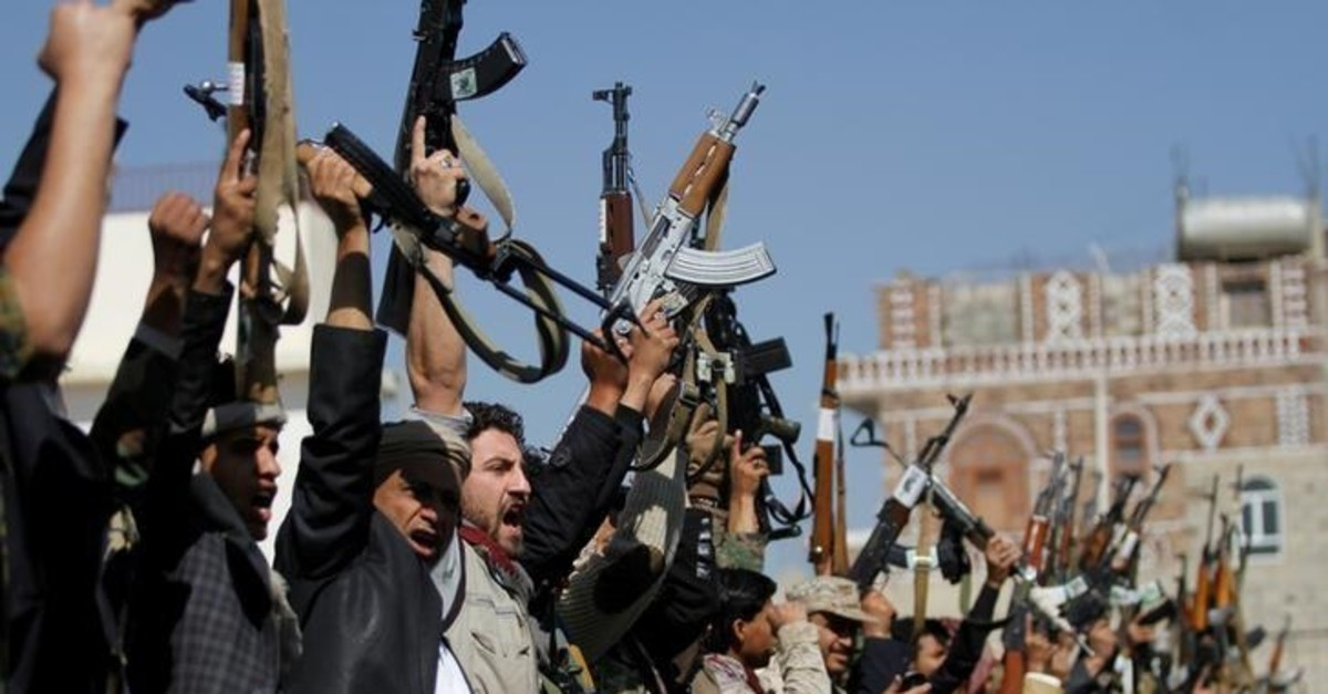 Tribesmen loyal to the Houthi movement hold their weapons as they attend a gathering to mark 1000 days of the Saudi-led military intervention in the Yemeni conflict, in Sanaa, Yemen December 21, 2017. (Reuters Photo)