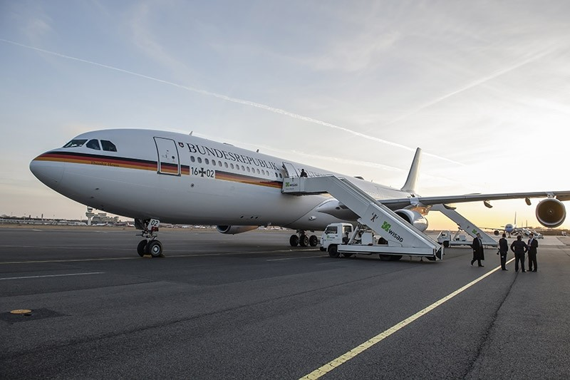 Journalists board the German Air Force plane Airbus A340 'Theodor Heuss' on the military part of Tegel Airport prior to the take off of German Chancellor Angela Merkel in Berlin, Germany, 16 March 2017. (EPA Photo)