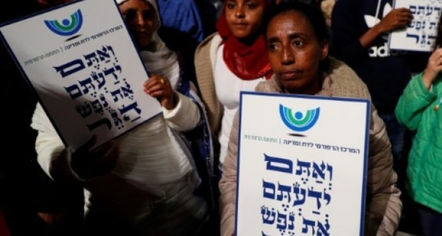 African migrants hold signs Hebrew signs: You come from the Bible, you too are refugees, during a demonstration in Tel Aviv (AFP File Photo)