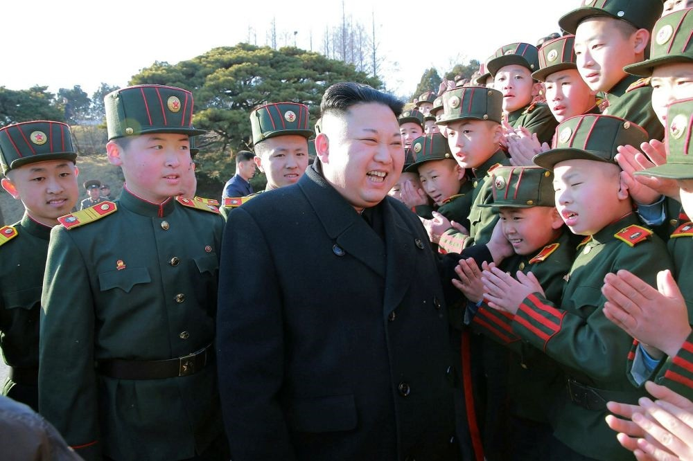 North Korean leader Kim Jong Un plants trees with students in Pyongyang on March 3.