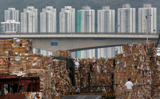 Tons of waste paper to be shipped to mainland China piled up at a dock in Hong Kong.