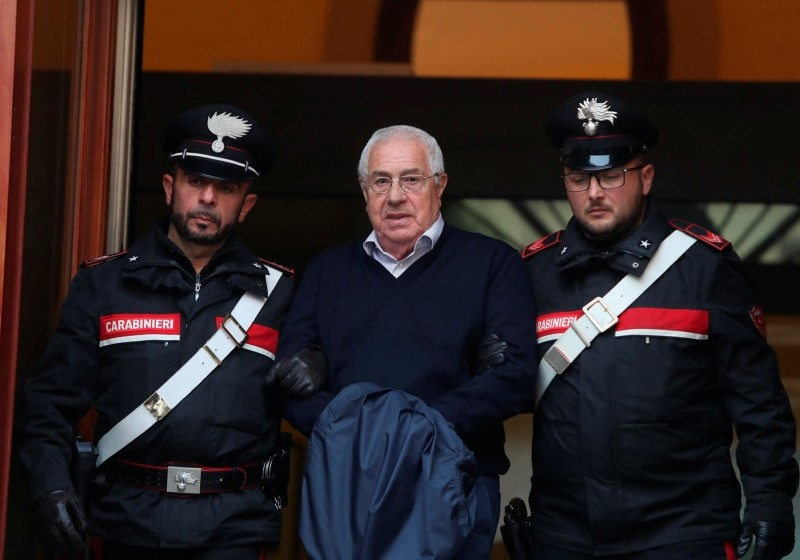 Settimo Mineo, who allegedly took over as the Palermo head of Cosa Nostra, is escorted by Italian Carabinieri police after an anti Mafia operation in Palermo, Italy, Dec. 4, 2018. (AP Photo)