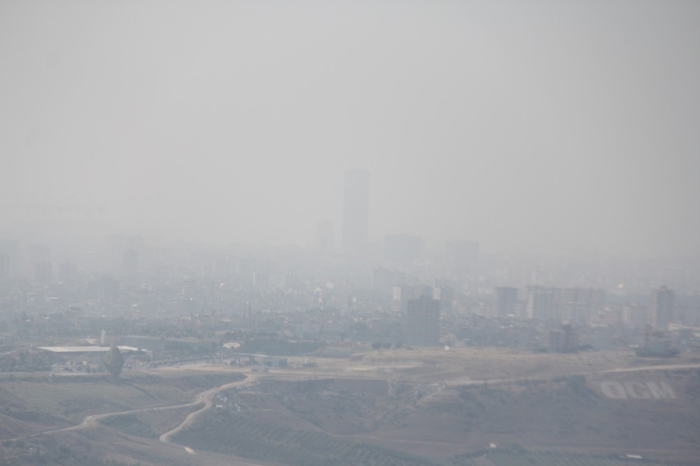 The southern city of Mersin can barely be seen through the fog of humidity. With temperatures 10 degrees above average, many are prefering to stay indoors rather than brave the extreme heat.