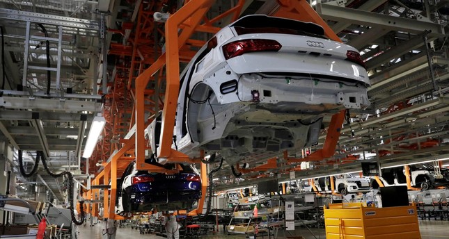 Employees work at an Audi Q5 2.0 production line of the German car manufacturer's plant during a media tour in San Jose Chilapa, Mexico, April 19, 2018.