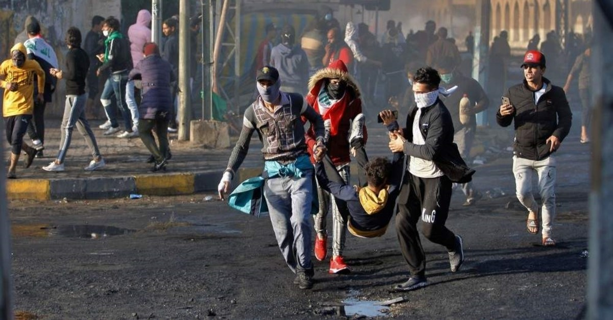 A wounded protester is carried to receive first aid during clashes, Najaf, Nov. 28, 2019. (AP Photo)