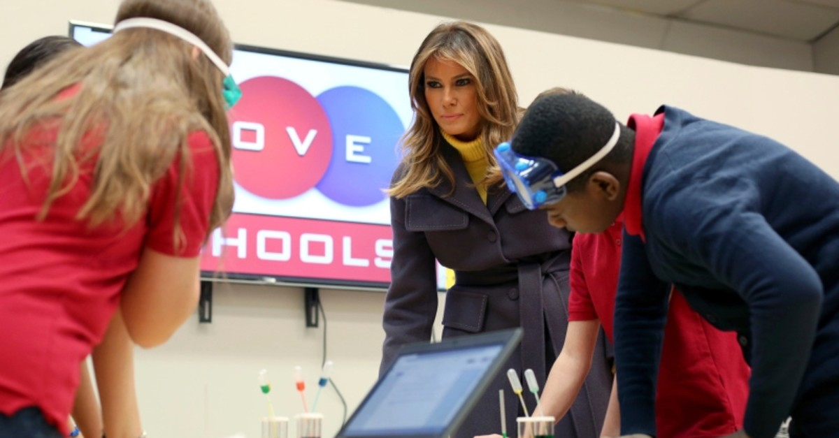 Melania Trump talks with sixth grade students who were working on an experiment in science class during a visit to Dove School of Discovery in Tulsa on Monday, March 4, 2019. (AP Photo)