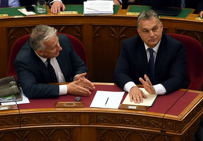Hungarian Prime Minister Viktor Orban (R) and Deputy Prime Minister Zsolt Semjen (L) attend a parliamentary meeting on Nov. 8, 2016 in Budapest. (AFP Photo)