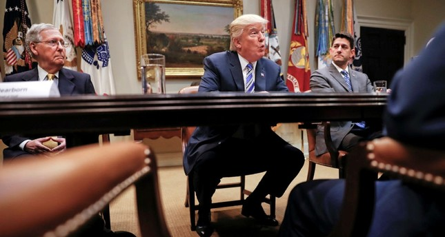 President Donald Trump, flanked by Senate Majority Leader Mitch McConnell of Ky., left, and House Speaker Paul Ryan of Wis., speaks at the White House in Washington. (AP Photo)