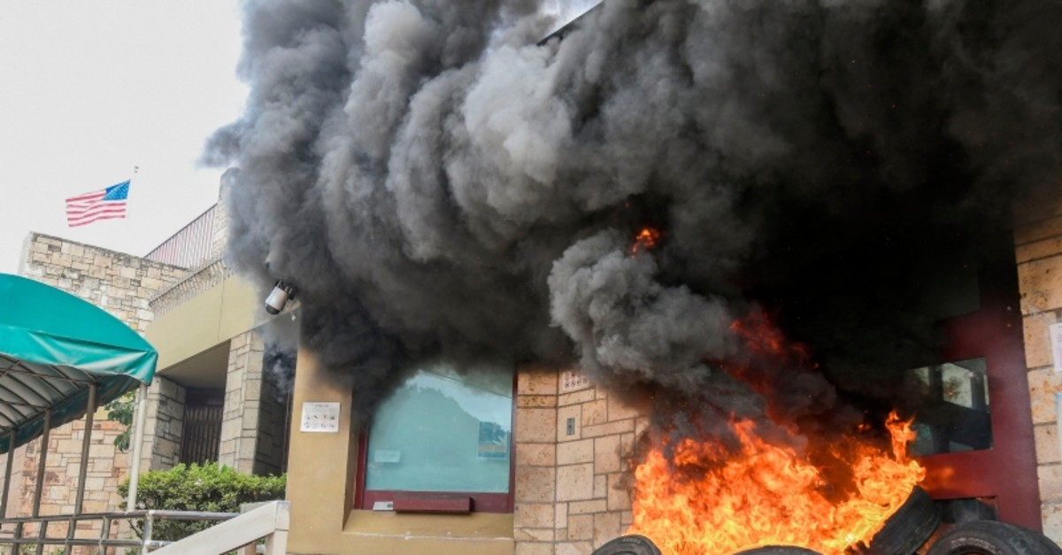 The entrance of the US embassy in Tegucigalpa burns after being set on fire by demonstrators of the education and health sectors protesting against government reforms, on May 31, 2019. (AFP Photo)