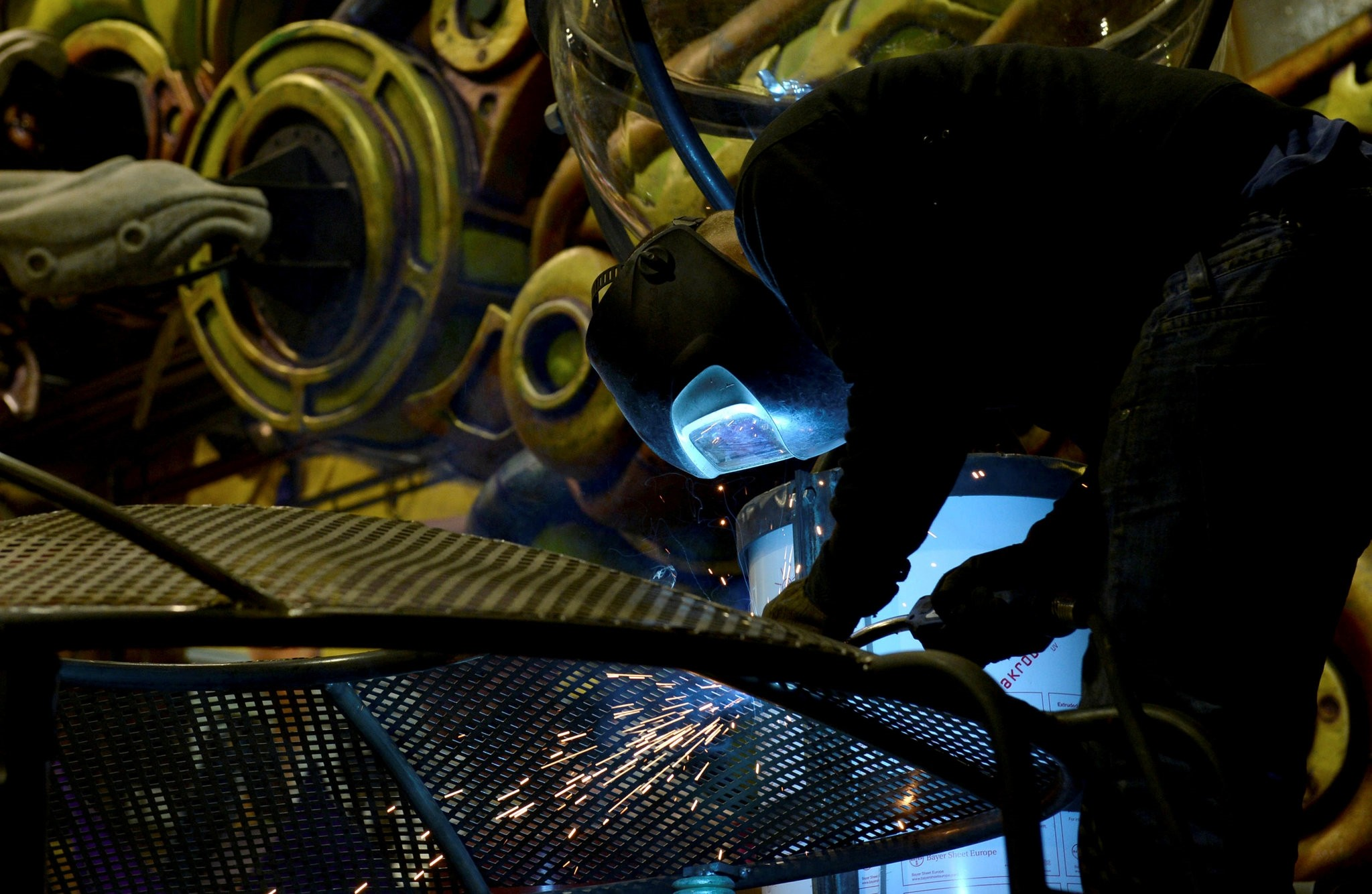 A welder works on the structure of a float as preparations continue for the Carnival parade in Nice, Feb. 11, 2014.