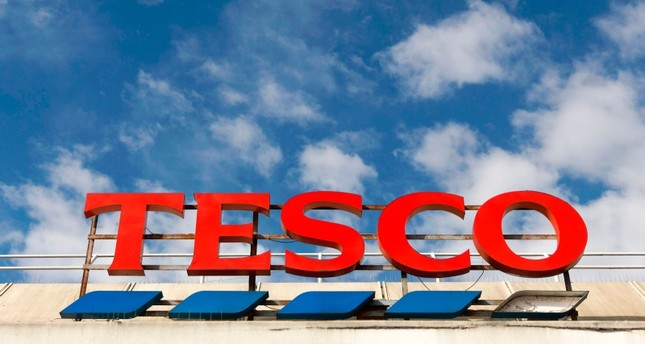 UK supermarket giant Tesco says 9,000 jobs will be axed in