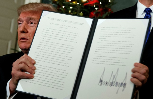President Donald Trump holds up a proclamation to officially recognize Jerusalem as the capital of Israel, in the Diplomatic Reception Room of the White House, Wednesday, Dec. 6, 2017, in Washington. (AP Photo)