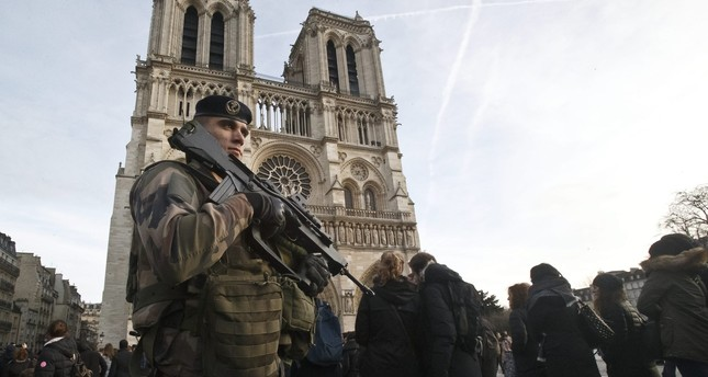 A soldier patrols at the Notre Dame cathedral in Paris, Dec. 30, 2015. (AP Photo)