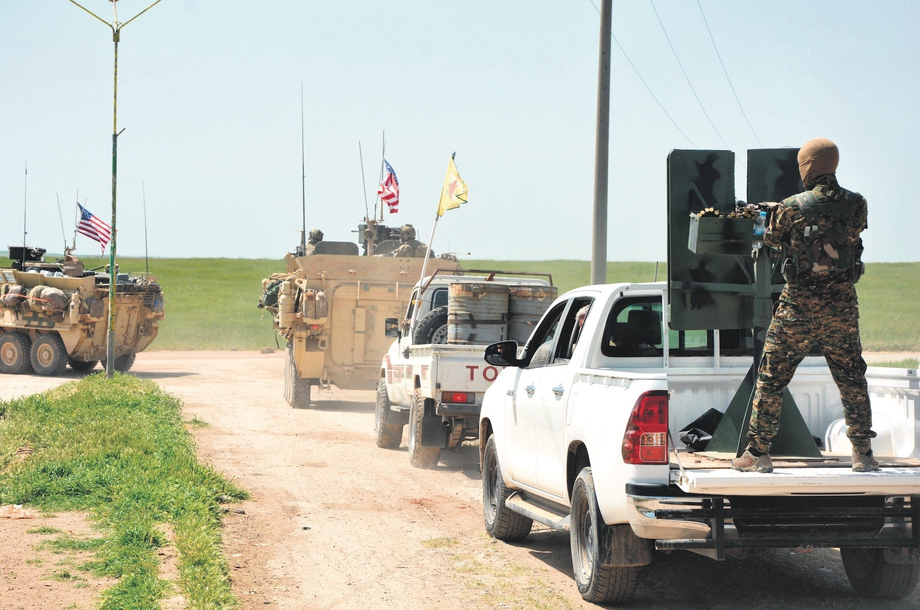 A convoy of U.S. troops and YPG terrorists patrol near the Syrian town of al-Darbasiyah at the Syrian-Turkish border, April 29.