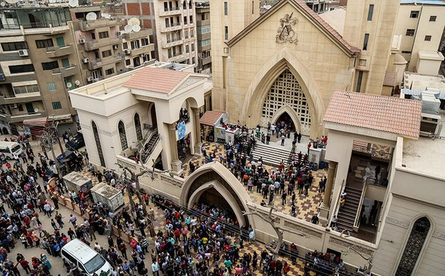 People gather in front of the Mar Girgis Church in Tanta, Egypt, April 09, 2017. (AA Photo)