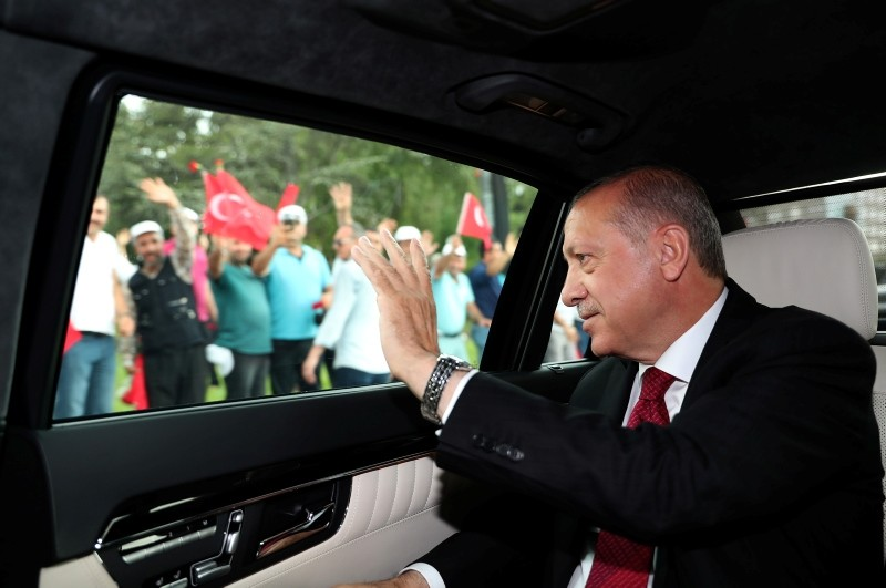 This hand out picture taken and released on July 9, 2018 by Turkish President Office shows President Recep Tayyip Erdoğan waving as he arrives at the Grand National Assembly of Turkey (TBMM) to take oath of office in Ankara.