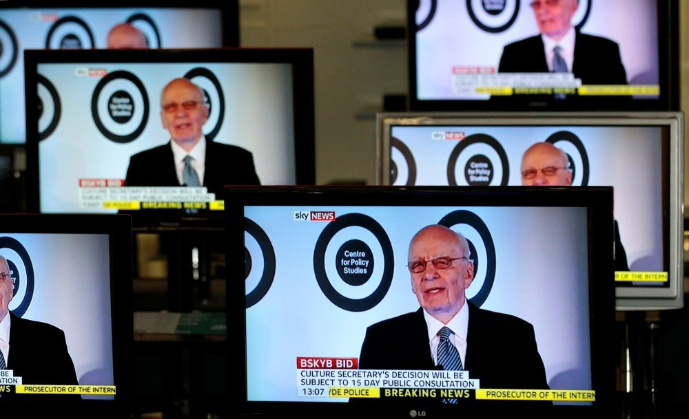 The current Executive Chairman of News Corporation and Executive Co-Chairman of Twenty-First Century Fox, Rupert Murdoch is seen talking on Sky News on television screens in an electrical store in Edinburgh.