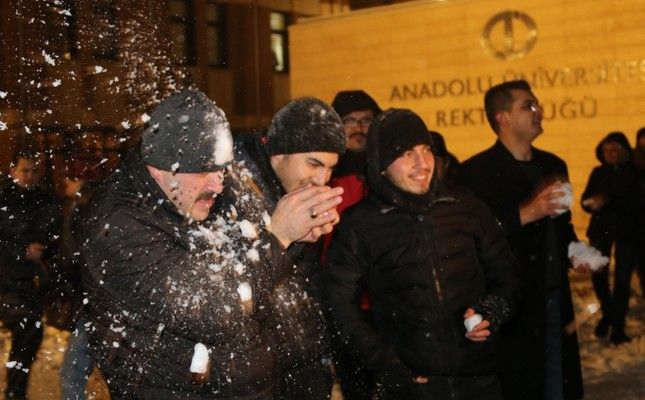 Anadolu University rector Şafak Ertan Çomaklı gets hit in head with a snowball, Eskişehir, Turkey, Jan. 15, 2019. (AA Photo)