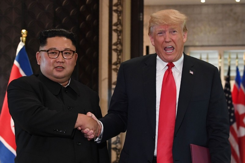 In this June 12, 2018, photo U.S. President Donald Trump, right, and North Korea's leader Kim Jong Un shaking hands following a signing ceremony during their historic summit, at the Capella Hotel on Sentosa island in Singapore. (AFP Photo)