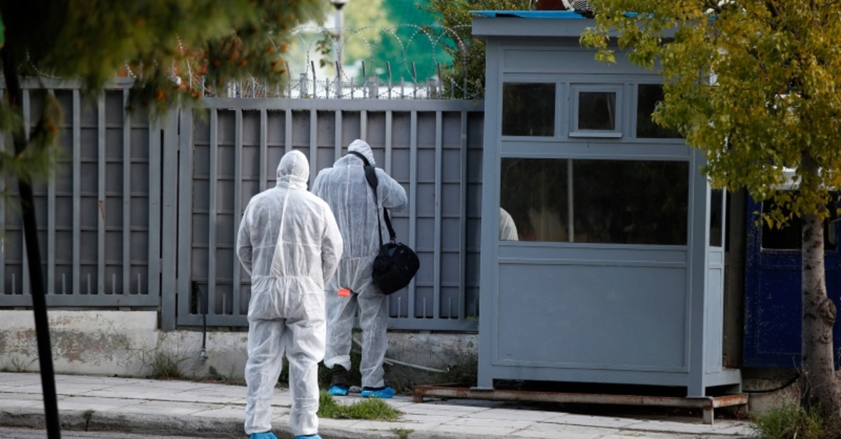 Forensic experts search the area outside the Russian consulate in Athens, Friday, March 22, 2019. (AP Photo)