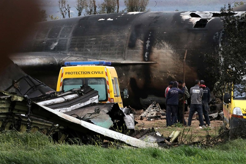 Algerian rescuers stand next to the wreckage of a military transport aircraft that crashed in Boufarik, about 30Kms south the capital Algiers, Algeria, 11 April 2018. (EPA Photo)